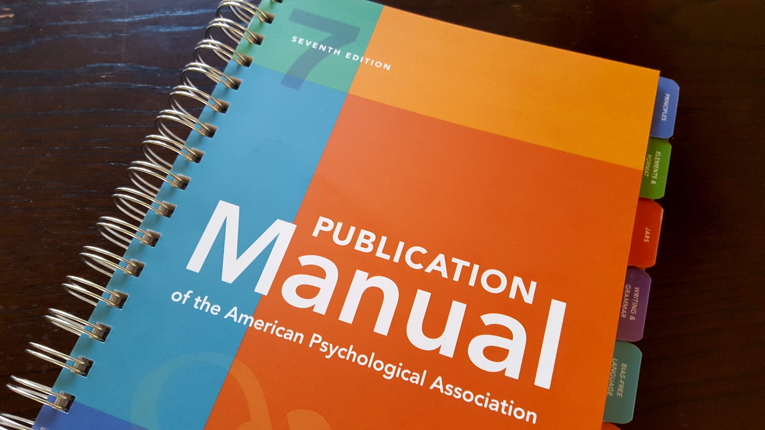 Cover of APA 7th publication manual spiral-bound tabbed edition